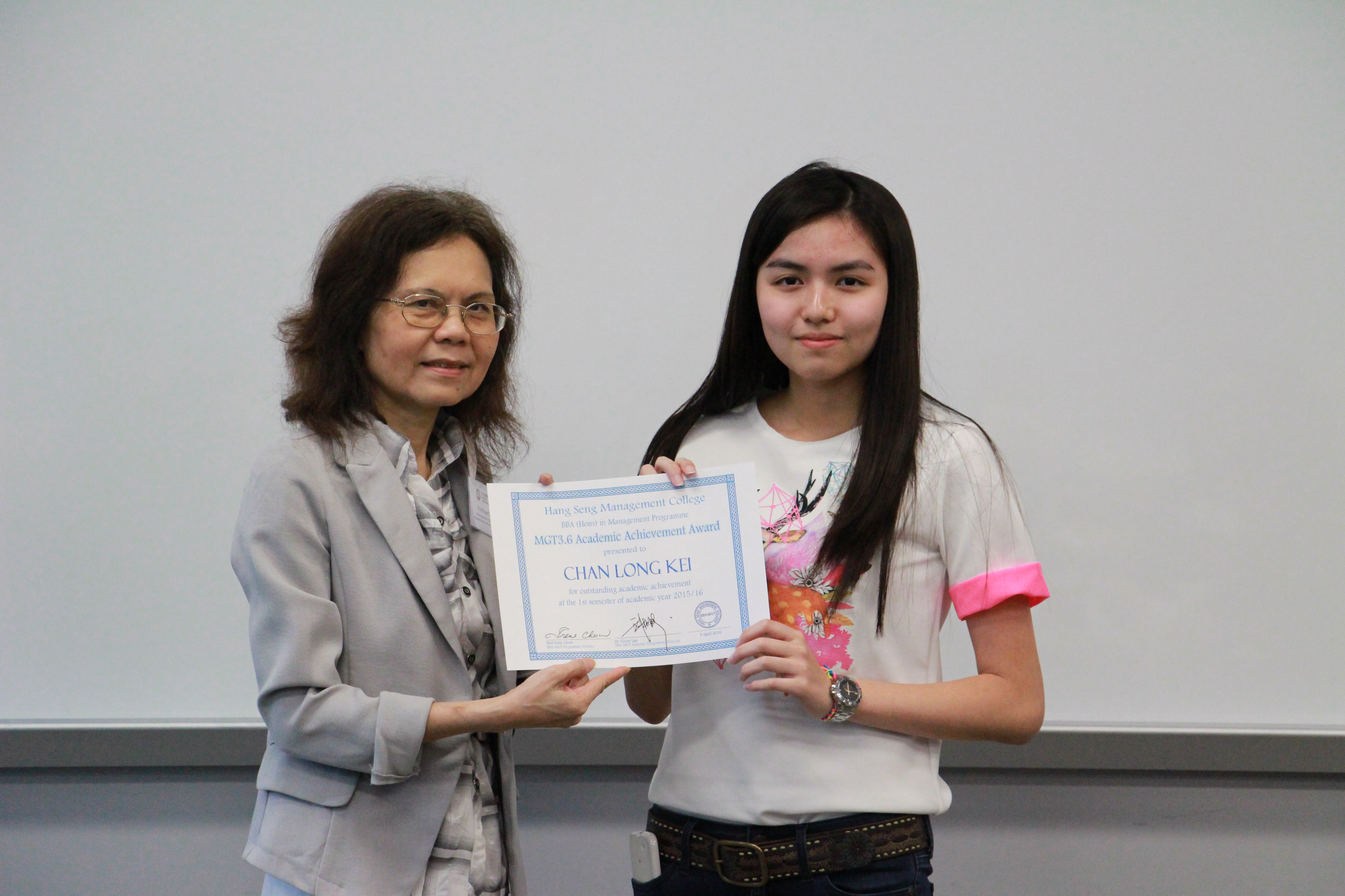 Prof Chow congratulates on her outstanding achievements.
