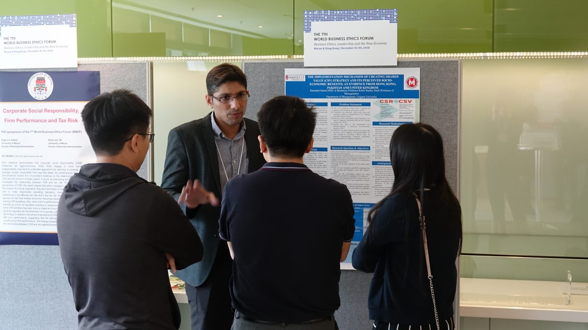 A PhD student presenting his research