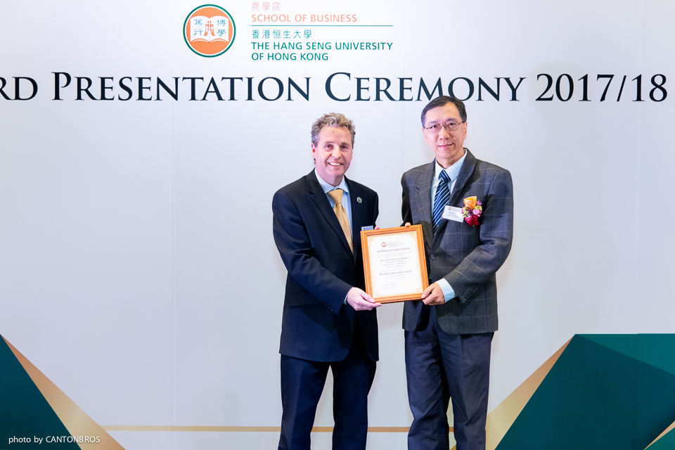 Prof Barnes (left) presented the award to Dr Haksin Chan