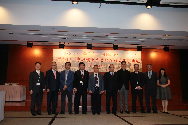 President Simon Ho; Professor Bradley R Barnes, Dean of School of Business, HSUHK; and Dr Ben Cheng (7th, 3rd and 2nd from right) pictured with Mr Matthew Cheung Kin-chung, Chief Secretary for Administration (5th from right) and other guests.
