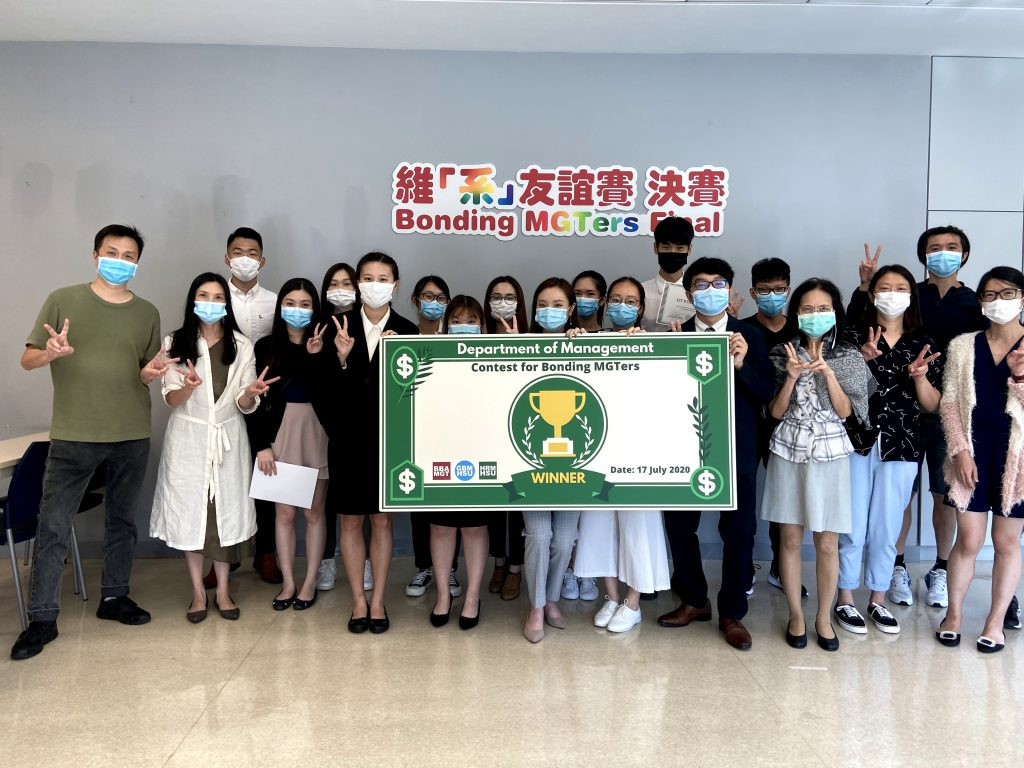 MGT students' group photo with smiling faces under the masks.